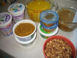 Pumpkin puree in containers, pumpkin juice, toasted pumpkin seeds.